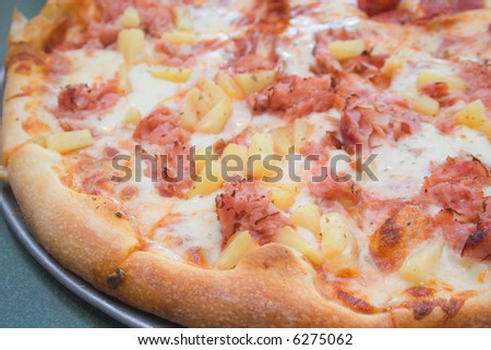 Close up of ham and pineapple pizza