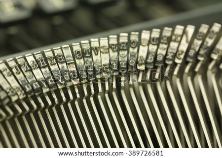 Close up of hammer keys on an old type writer. Shallow depth of field.