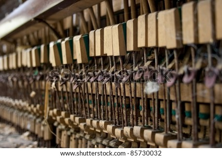 Close up of hammers on an old neglected piano - stock photo