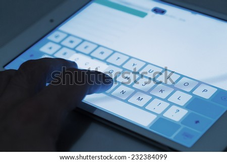 Close up of hand and tablet pc display - stock photo