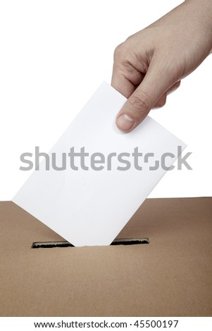 close up of hand and voting ballot - stock photo