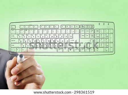 Close up of hand darwing computer keyboard with marker  - stock photo