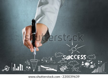 Close up of hand drawing business sketches on cement wall - stock photo
