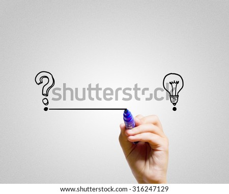 Close up of hand drawing line from question mark to idea - stock photo