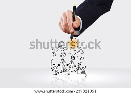 Close up of hand drawing sketches of happy family - stock photo