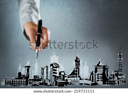 Close up of hand drawing with pen construction sketches - stock photo
