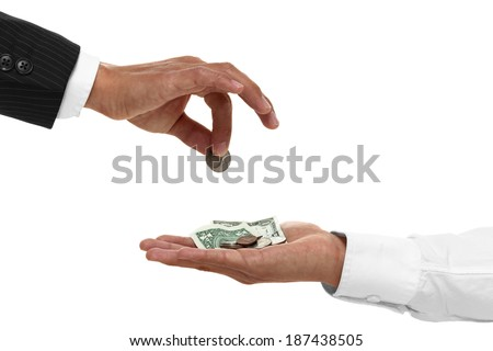 Close up of hand giving coins to a cupped hand
