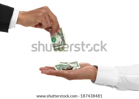 Close up of hand giving money to a cupped hand.
