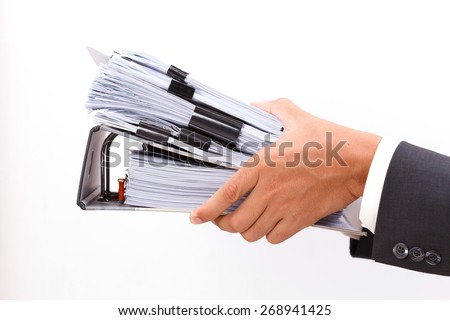 close up of hand holding binder on white background - stock photo