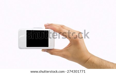 close up of hand holding camera on white background