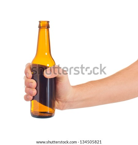 Close-up Of Hand Holding Empty Beer Bottle On White Background