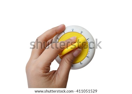 Close up of hand holding stopwatch On white background - stock photo