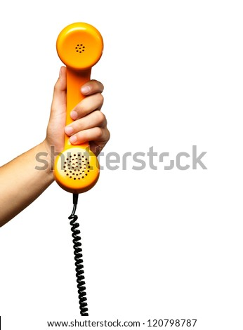 Close Up Of Hand Holding Telephone against a white background