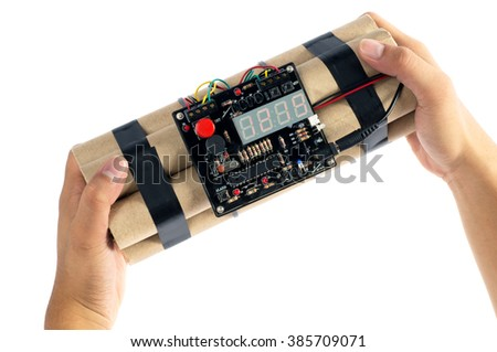 Close-up of hand holding time bomb on white background. - stock photo