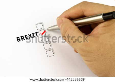 Close-up of hand making a selection on a checklist with word BREXIT.