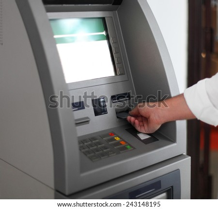 Close up of hand of a man using banking machine - stock photo
