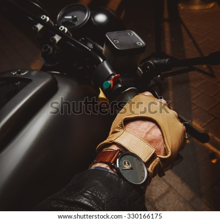 Close-up of hand of motorcyclist in protective glove  - stock photo