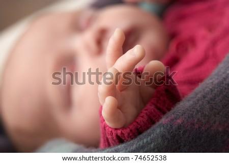 Close Up Of Hand Of Sleeping Newborn Baby Girl - stock photo
