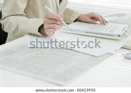 Close-up of hand of working woman - stock photo