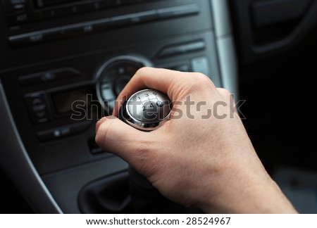 close up of hand on manual gear shift knob