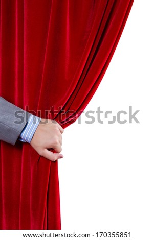 Close up of hand opening red curtain. Place for text - stock photo
