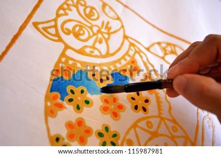 Close up of hand painting batik - stock photo