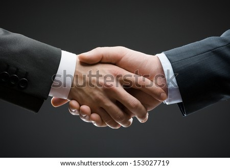 Close up of hand shake of business people. Concept of trustworthy relations and business cooperation - stock photo
