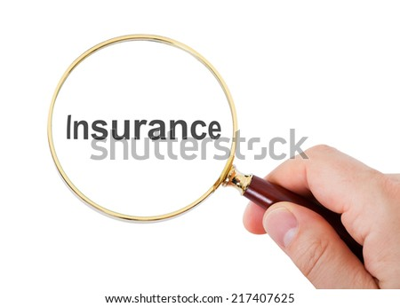 Close-up Of Hand Showing Insurance Word Through Magnifying Glass Over White Background - stock photo
