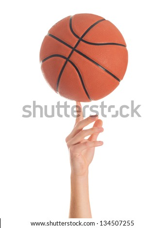 Close-up Of Hand Spinning Basket Ball On White Background - stock photo