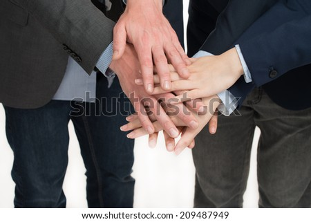 Close-up Of Hand Stacked Over Each Other On White Background.