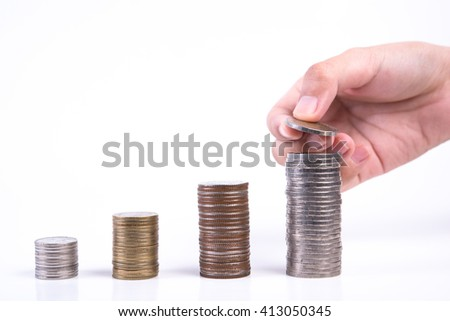 Close up of hand stacking coins on white background, Money growing concept, Save money with stack money coin for growing your business - stock photo