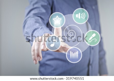 Close up of hand touching music icon with finger