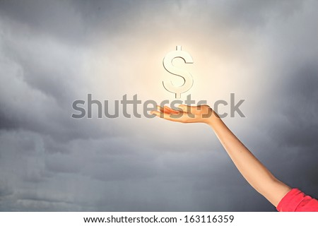 Close-up of hand with dollar sign. Currency concept