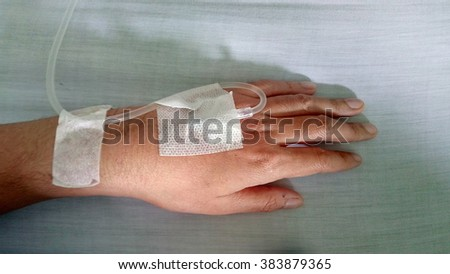 close up of  hand with drip in hospital - stock photo