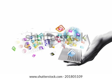 Close up of hand with laptop and media icons. Elements of this image are furnished by NASA