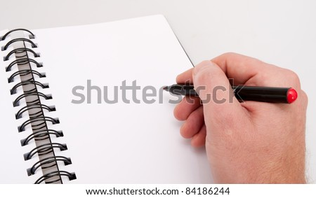 Close up of Hand With Red Marker - Open Notebook- Personal Organizer - stock photo