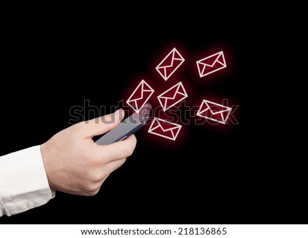 Close up of hand with smart phone and email icons - stock photo