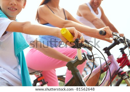 Close-up of handlebar of one of family bikes - stock photo