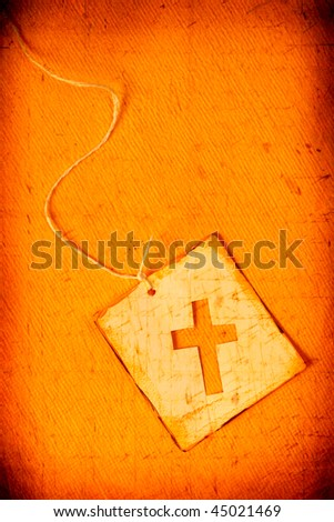 Close up of handmade paper tag with holy cross - stock photo