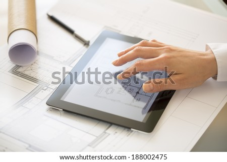 Close-up Of Hands Architect Woman Using Tablet Pc  - stock photo
