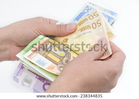 Close-up of hands counting euro banknotes - stock photo