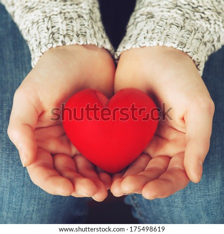 close up of hands holding a heart - stock photo
