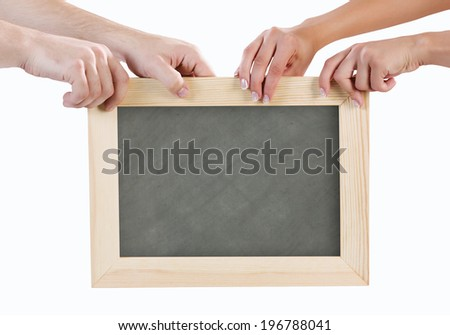 Close up of hands holding blank chalkboard - stock photo