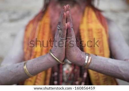 Close-up of Hands in Namaste prayer mudra by Indian Sadhu man. - stock photo