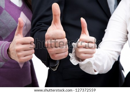 Close- up of hands of business group  showing sign ok - stock photo