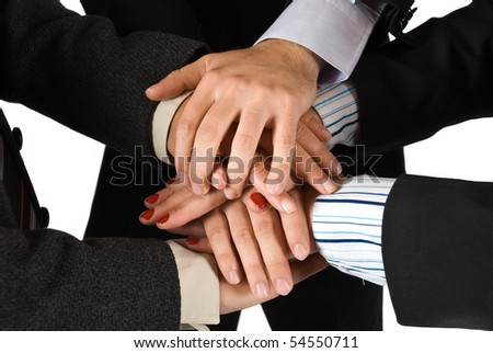 Close up of hands of several business people colleagues showing unity