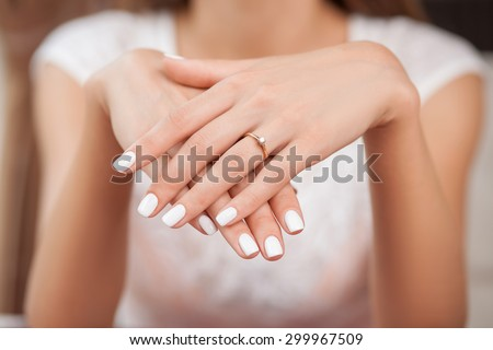 Close up of hands of woman showing the ring with diamond. She is engaged - stock photo