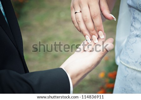 close-up of hands of women and men who were married