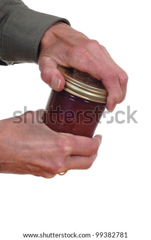 Close up of hands opening a jar. - stock photo