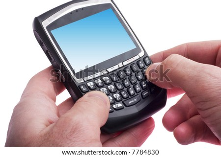close up of hands typing on a Blackberry - stock photo
